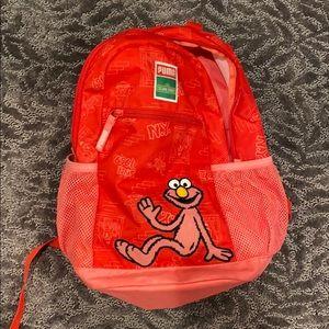 Great condition Puma Elmo backpack & stuffed Elmo